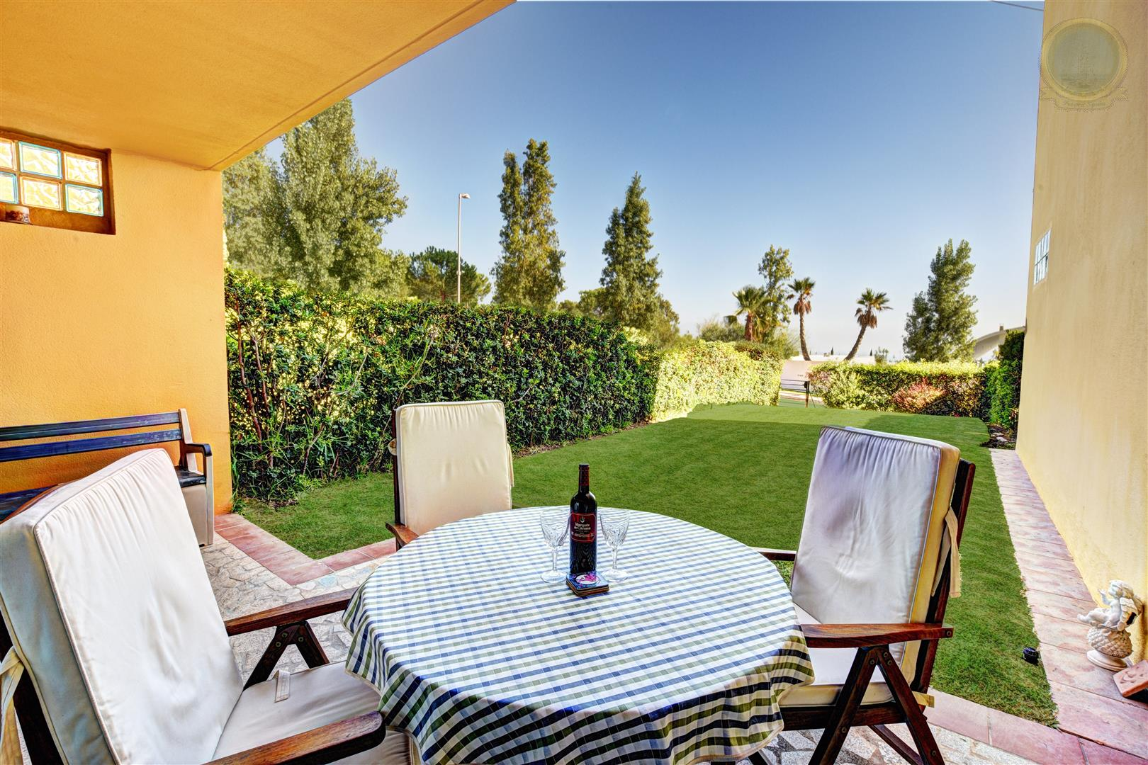 garden view of townhouse in Higueron for sale